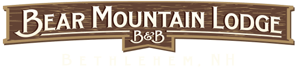 Illustration of wooden rectangle sign that reads Bear Mountain Lodge