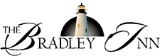 Small Logo with an image of a Light House with the text - The Bradley Inn