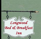 Illustration of Wooden sign hung from iron framing - Longwood Inn