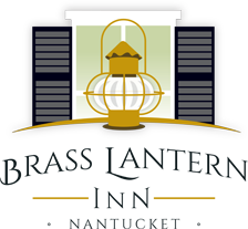 Logo - Illustration of Brass Lantern in front of white window with black shutters with the text below BRASS LANTERN INN NANTUCKET
