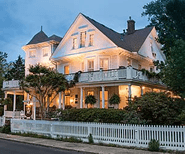 bright sky , picket fence , exterior of the inn